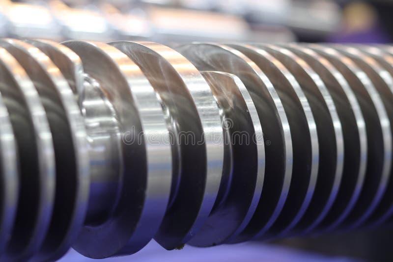 Pièces de presse à vis pour la machine en plastique d'injection photographie stock libre de droits