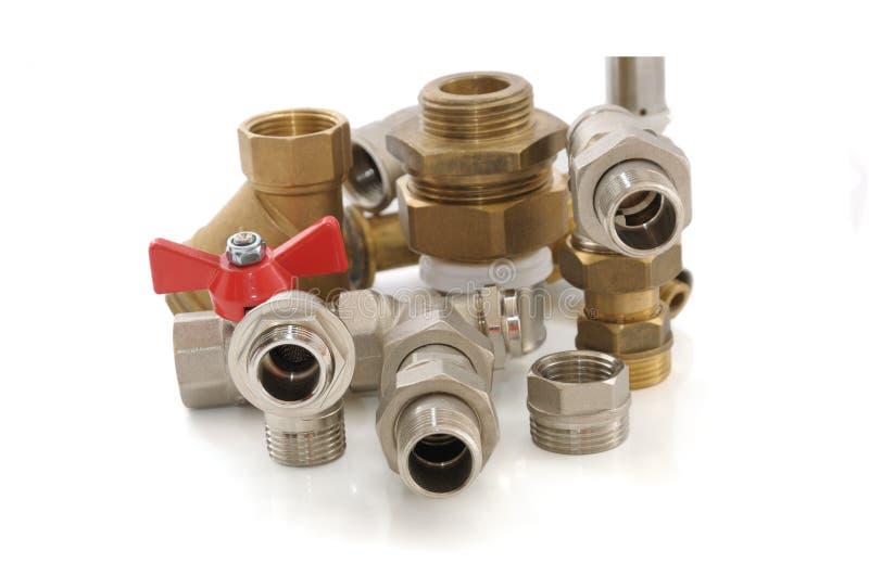 Pièces en métal pour la tuyauterie et le matériel sanitaire photo libre de droits