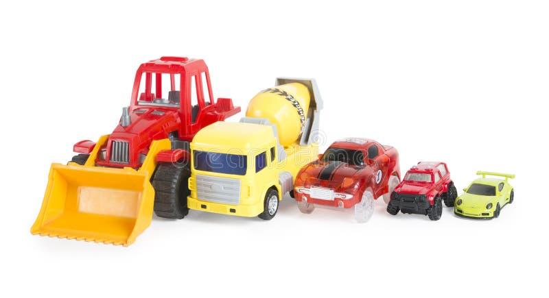 Pięć budowa i bieżni kolorowi zabawkarscy samochody odizolowywający zdjęcia royalty free