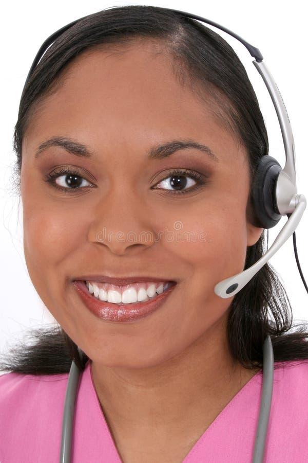 piękną słuchawki recepcjonistki nosić medyczny obrazy stock