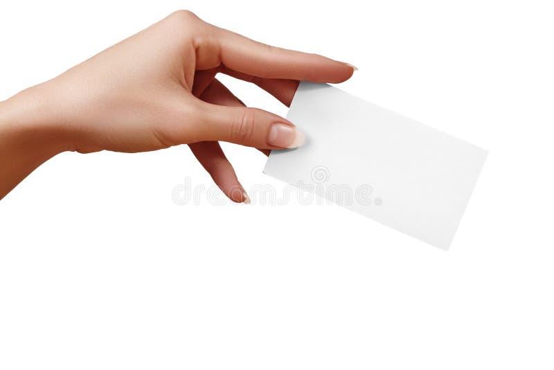 Piękna żeńska ręki mienia papieru wizytówka na białym tle Prezent karta, cutaway, graficzny projekt zdjęcie stock