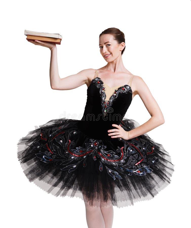 Piękna balerina z książkami na białym tle fotografia royalty free