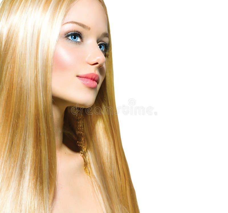 Piękna Blond dziewczyna nad bielem obrazy royalty free