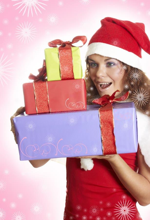 piękna bożych narodzeń prezenta dziewczyna zaskakująca zdjęcie stock