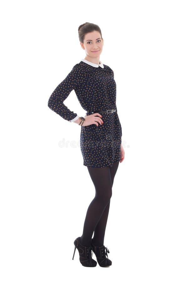 Piękna brunetki kobieta w czerni smokingowy pozować odizolowywam na bielu obrazy royalty free