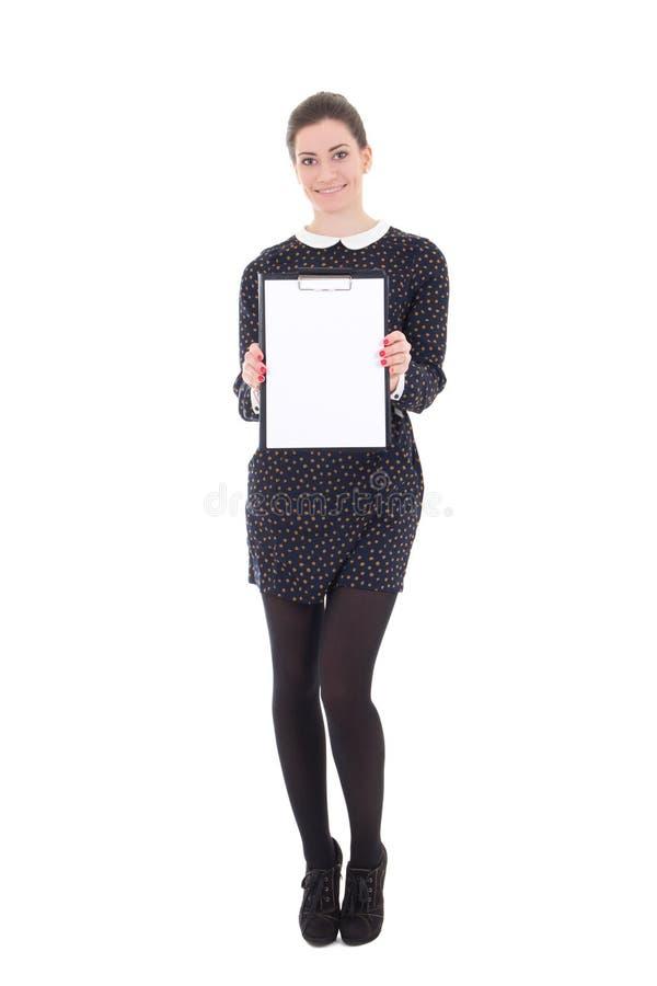 Piękna brunetki kobieta w czerni sukni z schowkiem odizolowywającym zdjęcia royalty free