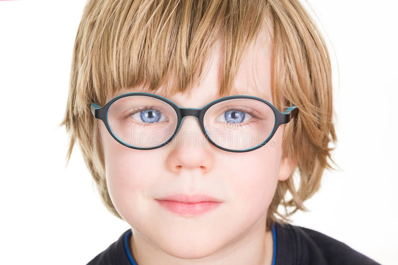 Piękna chłopiec z szkłami fotografia royalty free