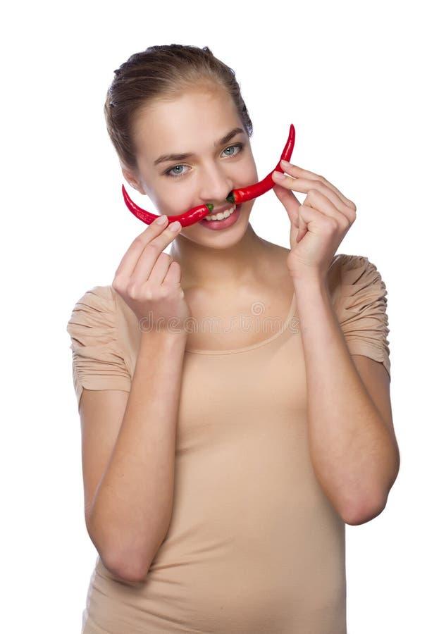 Piękna czarcia dziewczyna z gorącego chili pieprzem zdjęcie royalty free