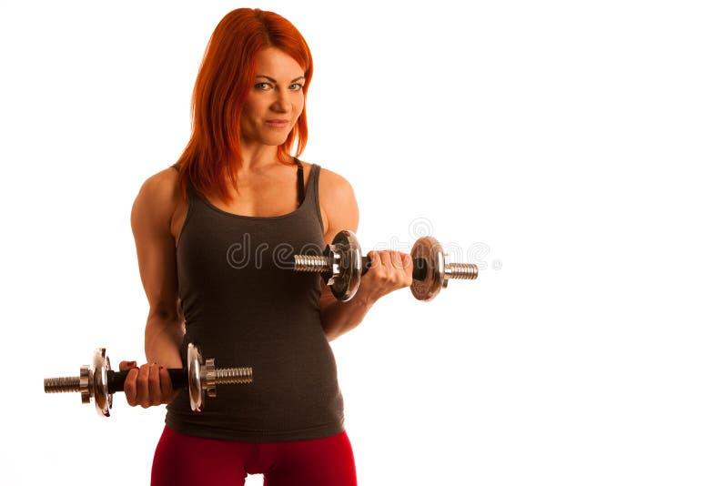 Piękna dysponowana kobieta pracująca w gym out - dziewczyna w sprawności fizycznej zdjęcie royalty free