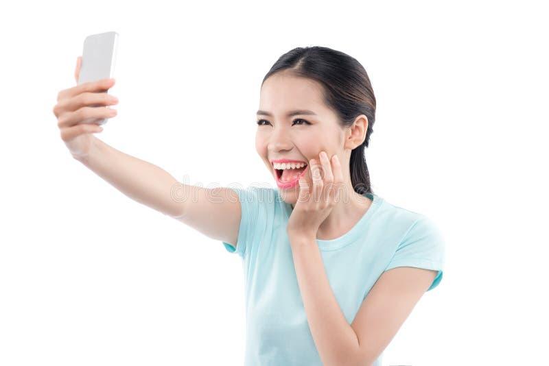 Piękna dziewczyna bierze selfie fotografia stock
