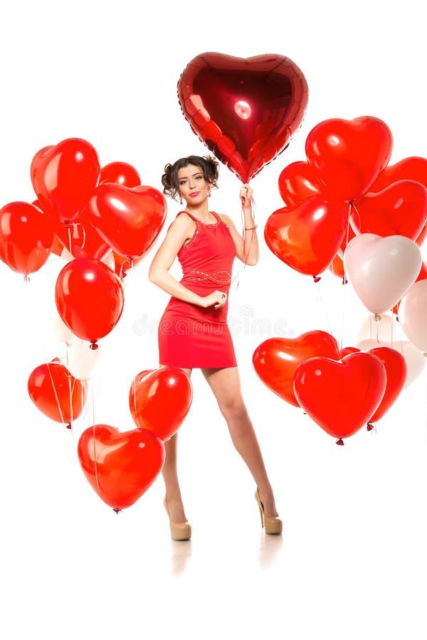 Piękna dziewczyna, elegancki moda model z balonami w kształcie obraz stock