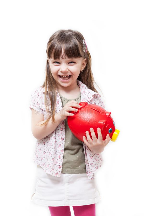 Piękna dziewczyna trzyma czerwonego prosiątko banka obraz royalty free