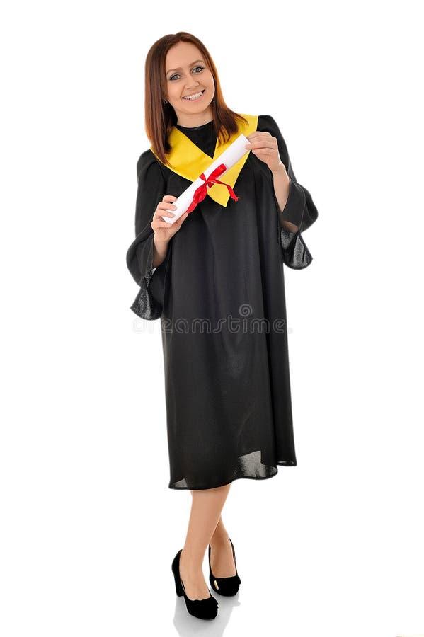 Piękna dziewczyna w czarnej todze magisterska pozycja z s obraz stock