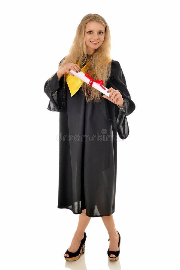 Piękna dziewczyna w czarnej todze magisterska pozycja z s zdjęcie stock