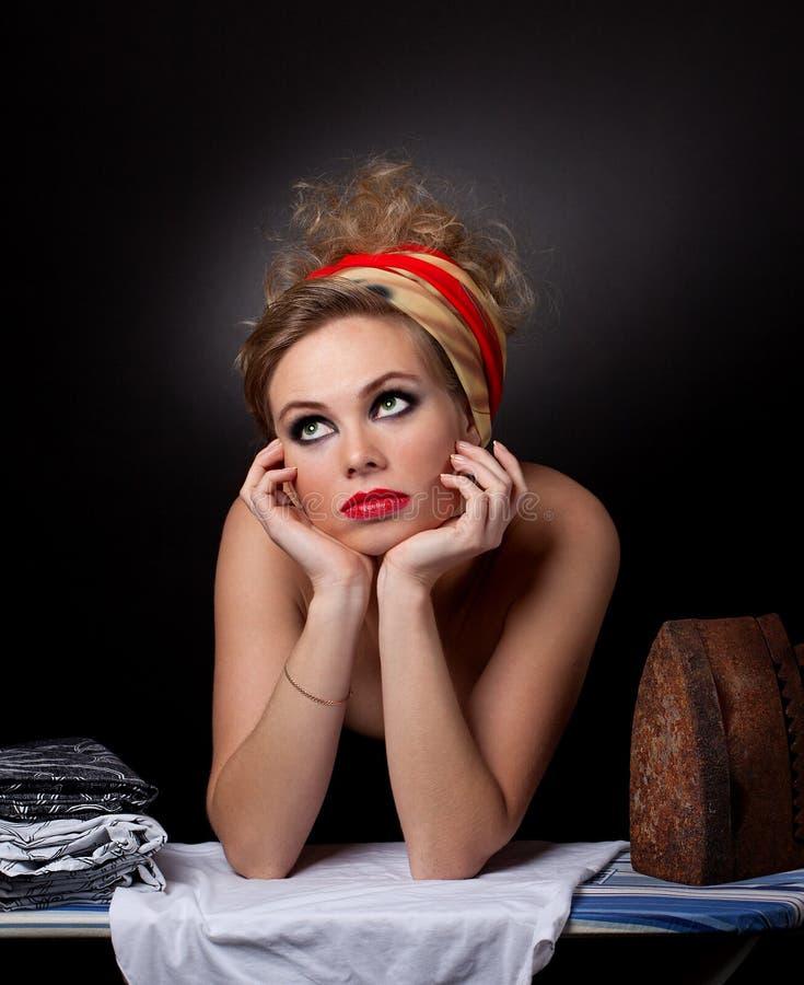 Piękna dziewczyna z żelazem fotografia royalty free
