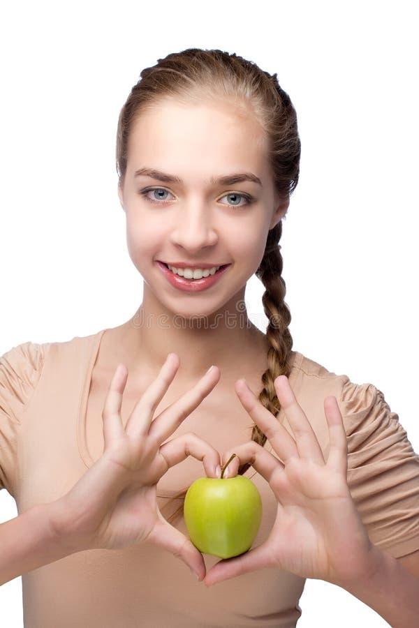 Piękna dziewczyna z zielonym jabłkiem obrazy royalty free