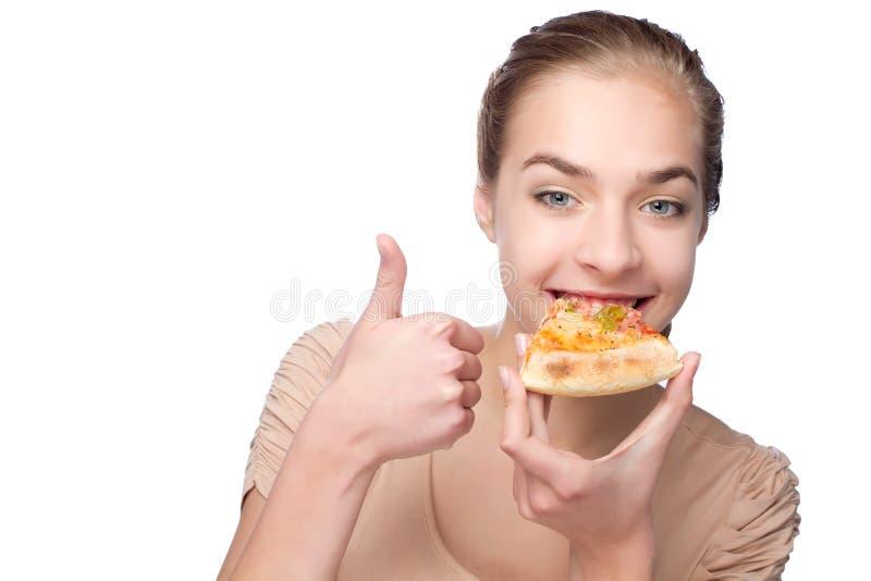 Piękna dziewczyny łasowania pizza i seansu kciuk obraz royalty free