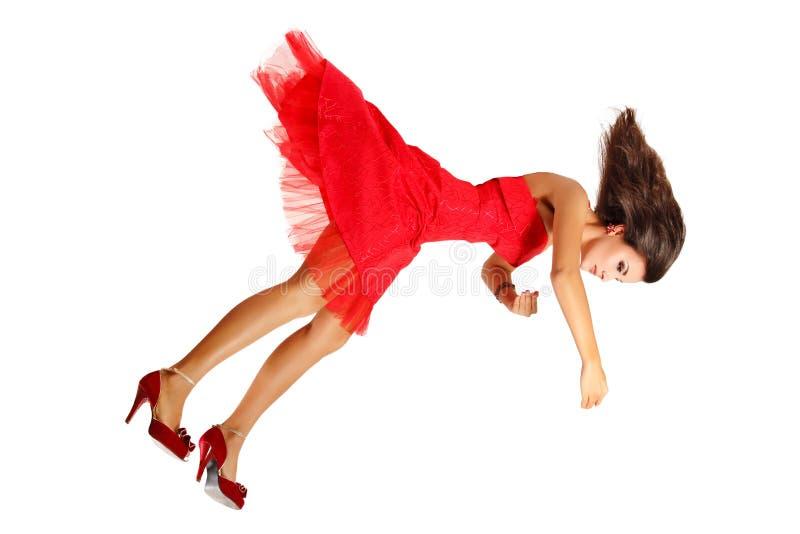 Piękna kobieta łamający lala spada puszek odizolowywający na bielu zdjęcie royalty free