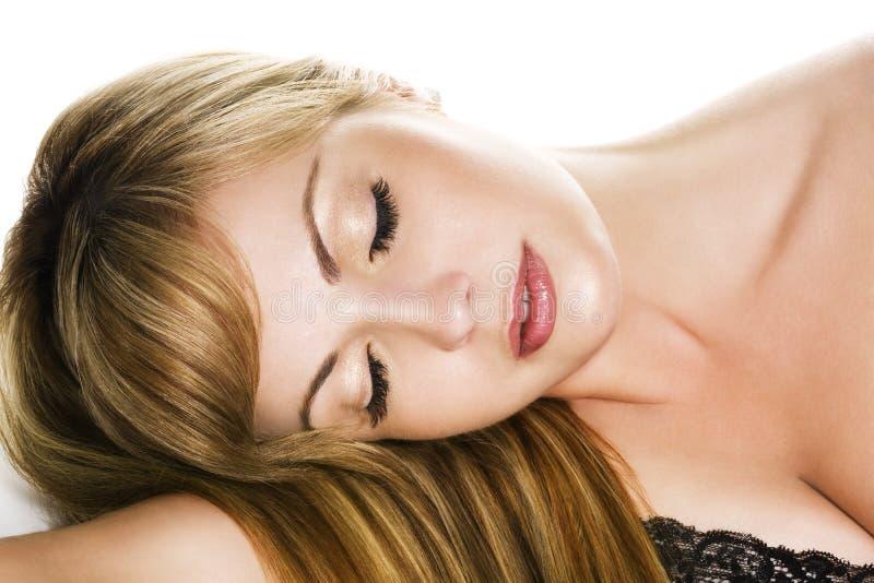 piękna kobieta sypialna zdjęcie stock
