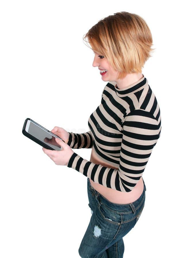Piękna kobieta Texting na pastylce zdjęcie royalty free