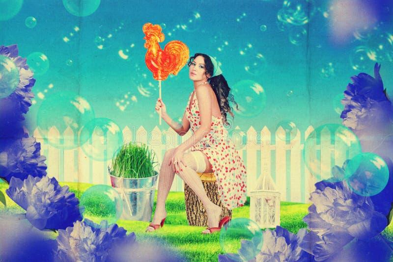 Piękna kobieta w czarodziejka ogródzie obraz royalty free