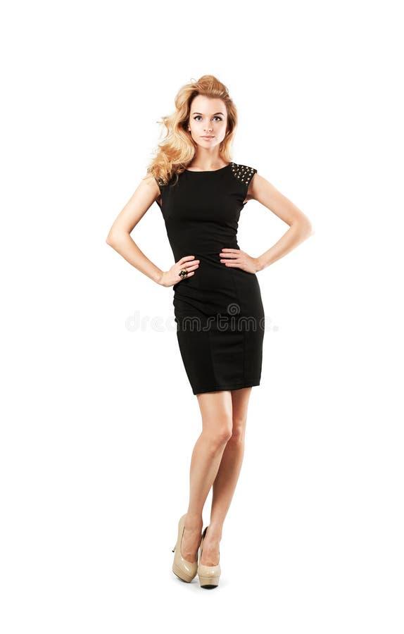 Piękna kobieta w czerni sukni Odizolowywającej na bielu obraz stock