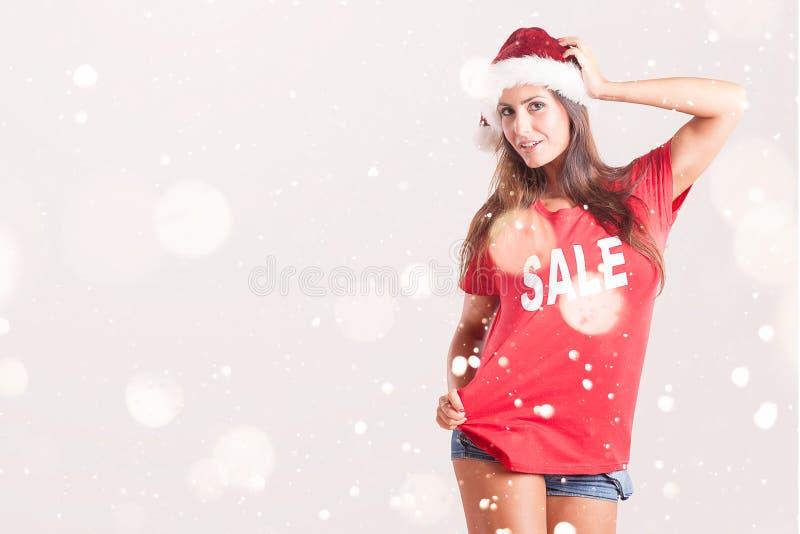 Piękna kobieta W Czerwonej koszula i Santa kapeluszu obrazy stock