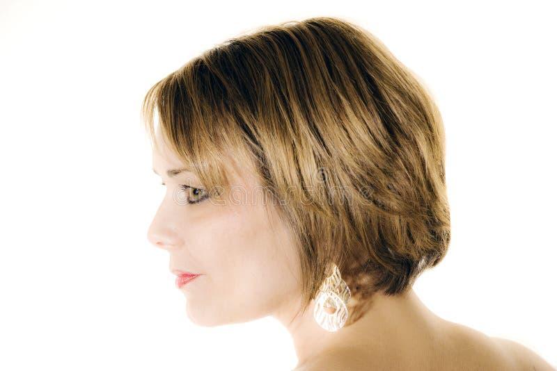 Piękna kobieta w profilu odizolowywającym na bielu obrazy stock