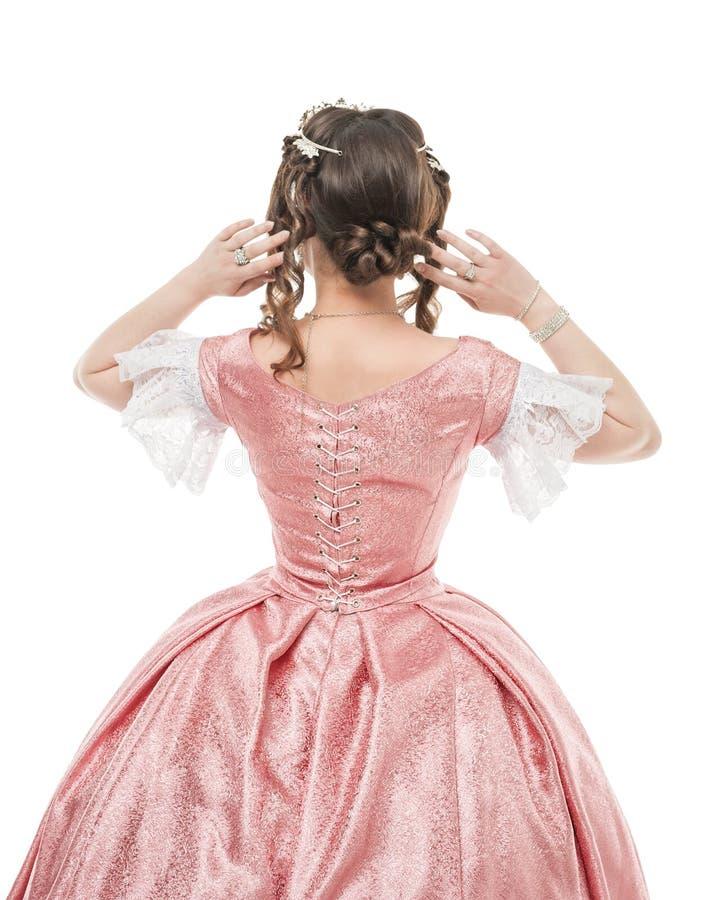 Piękna kobieta w starej historycznej średniowiecznej sukni Tylna poza obraz royalty free