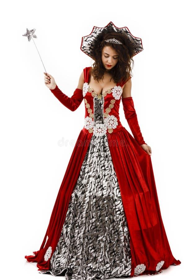 Piękna kobieta z czarodziejską suknią fotografia royalty free