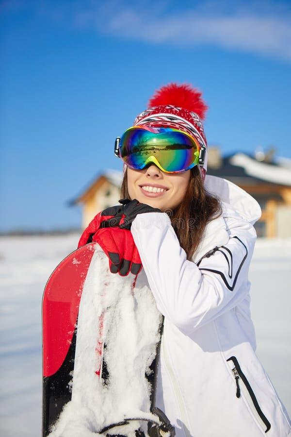 Piękna kobieta z snowboard pojęcie odizolowywający sporta biel zdjęcia royalty free