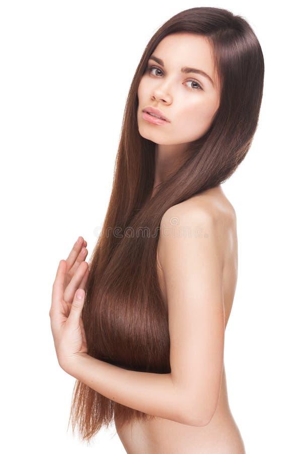 Piękna młoda brunetki kobieta z długi prostym obraz royalty free