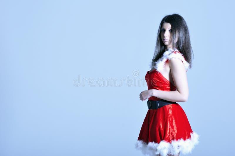 Piękna młoda kobieta w Santa kostiumu zdjęcie stock