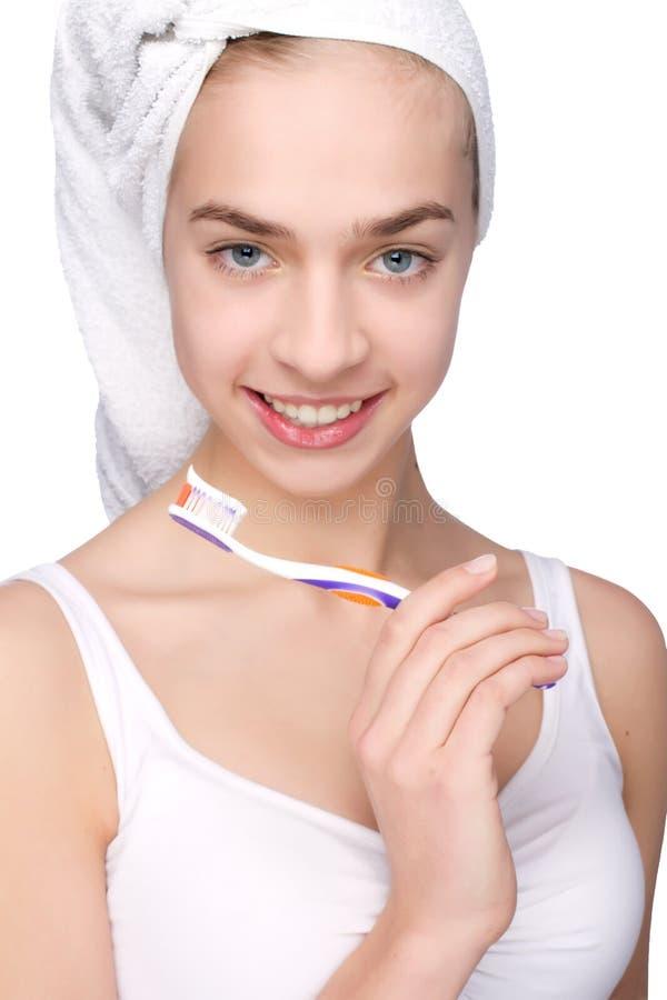 Piękna młoda kobieta z toothbrush w ona ręki obraz stock