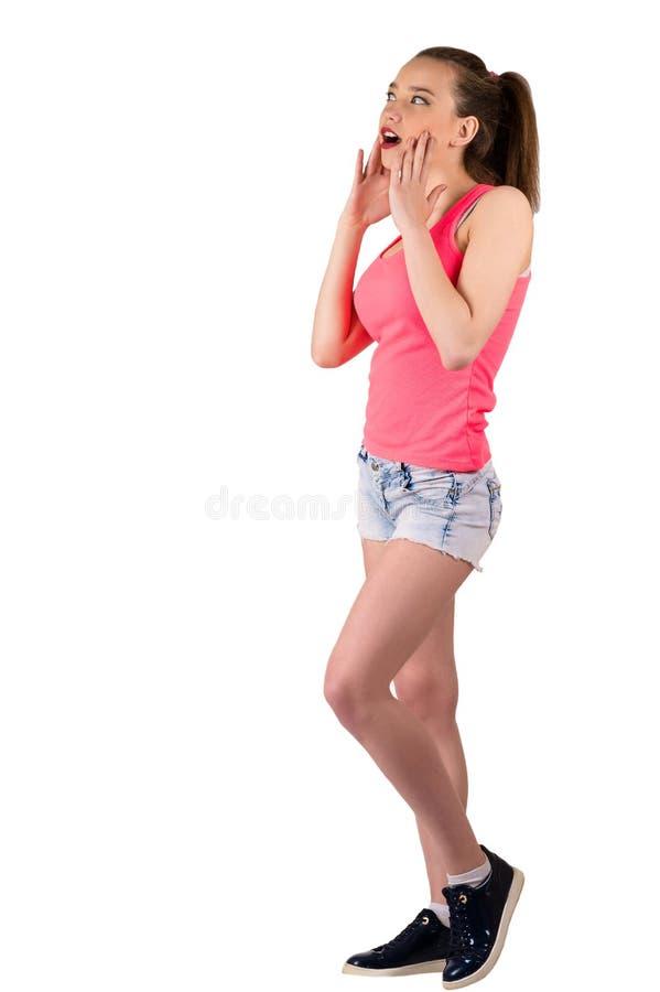 Piękna młoda nastolatek dziewczyny pozycja w pełnej długości zaskakującej obraz stock