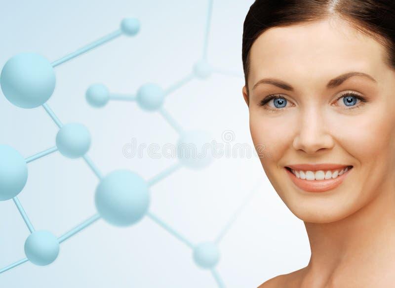 Piękna młodej kobiety twarz z molekułami zdjęcia royalty free