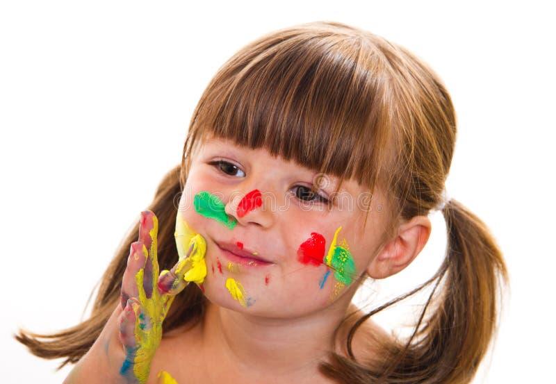 Piękna mała dziewczynka z malującą twarzą fotografia stock
