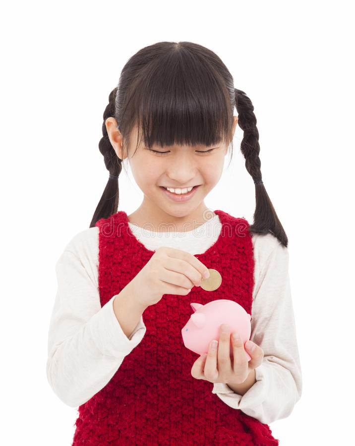 Piękna mała dziewczynka z prosiątko bankiem obrazy royalty free