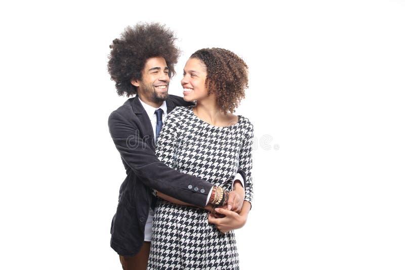 Piękna miłości para przed białym tłem robi wyrażeniom zdjęcie stock