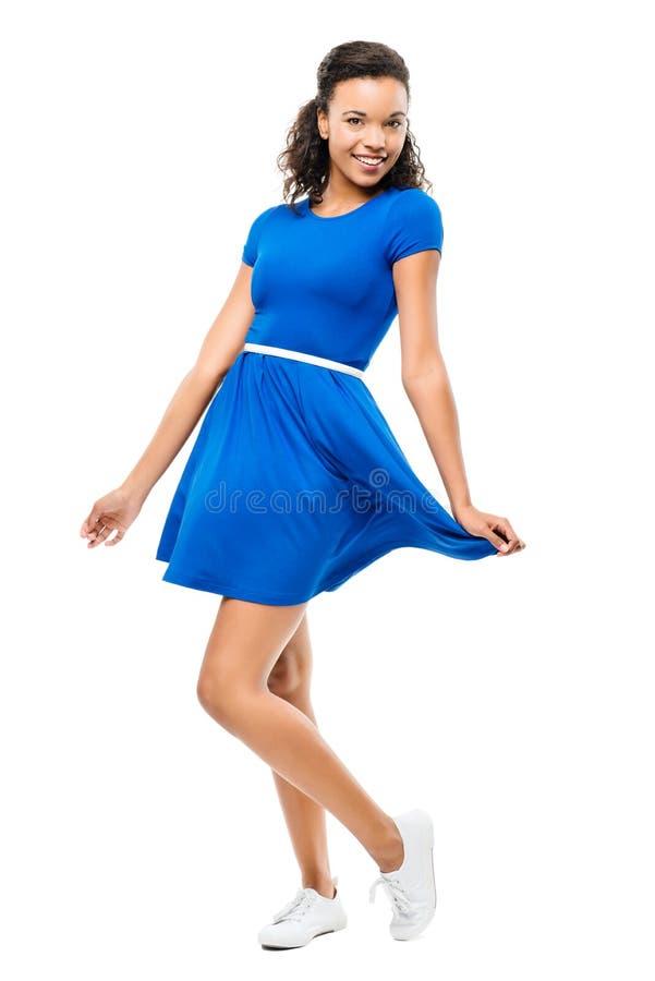 Piękna mieszana biegowa kobieta tanczy seksowną błękit suknię odizolowywającą na w obraz royalty free