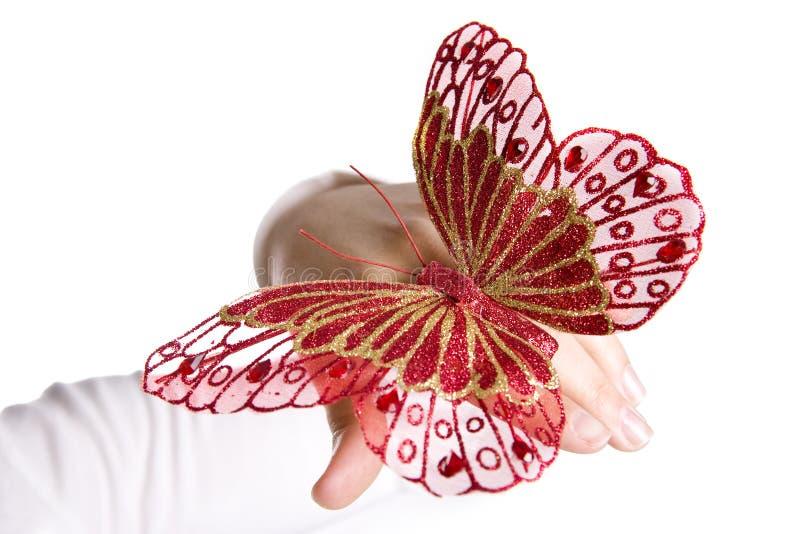 piękna motylia ręce czerwoną kobieta fotografia stock