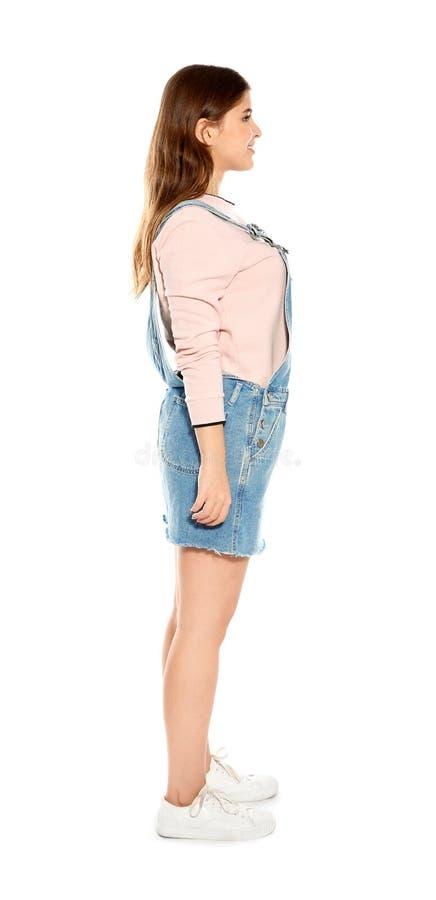 Piękna nastoletnia dziewczyna w eleganckim odziewa na bielu obraz stock