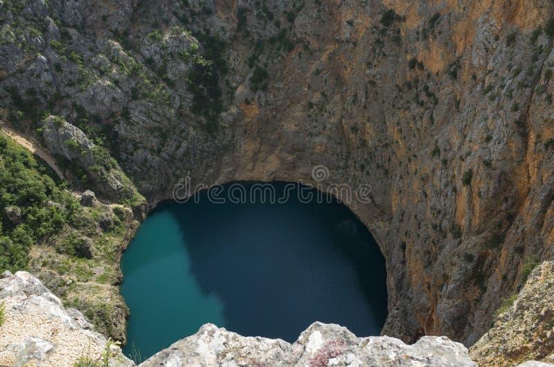 Piękna natury i krajobrazu fotografia Czerwony Jeziorny Imotski Chorwacja obrazy royalty free