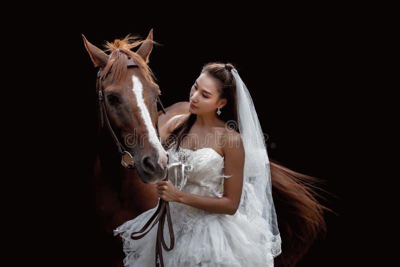 Piękna panna młoda z koniem zdjęcie royalty free