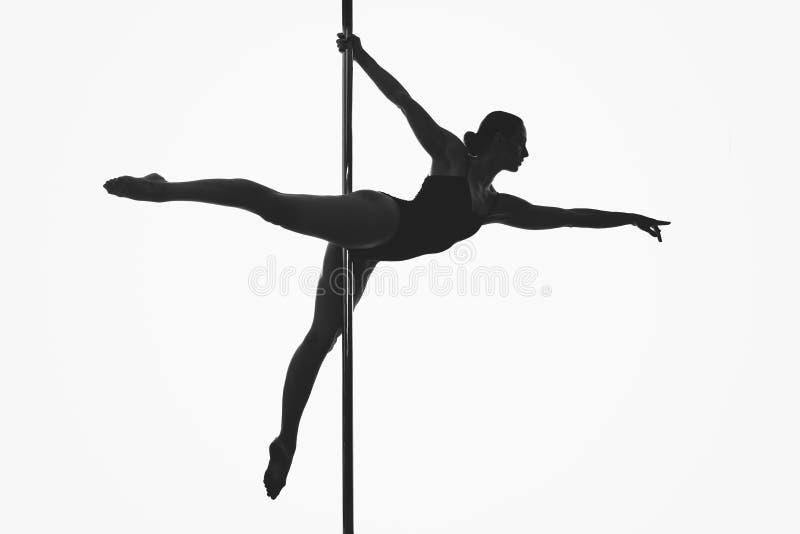 Piękna słupa tancerza dziewczyny sylwetka zdjęcia stock