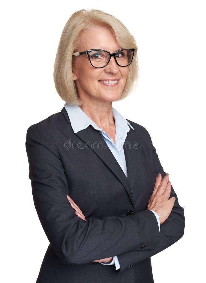 Piękna starsza biznesowa kobieta odizolowywająca zdjęcie royalty free