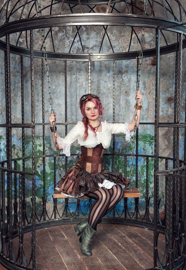 Piękna steampunk kobieta w klatce obrazy stock
