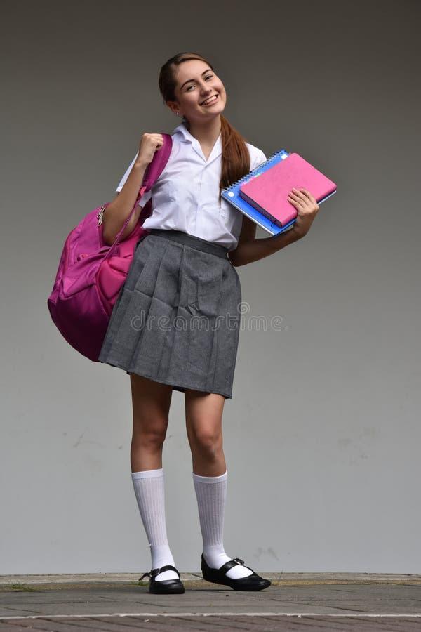 Piękna Studencka nastolatek szkoły dziewczyna Podczas gdy Stojący obrazy stock