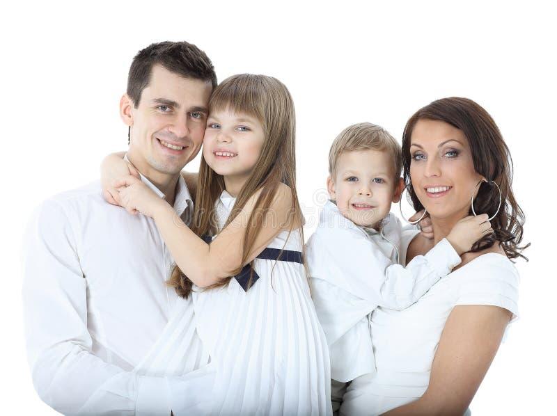 Piękna szczęśliwa rodzina - odizolowywająca nad białym tłem zdjęcia stock