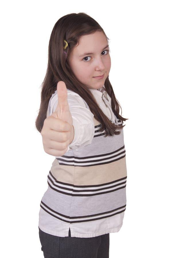 Piękna szkolna dziewczyna pokazuje kciuk up fotografia royalty free